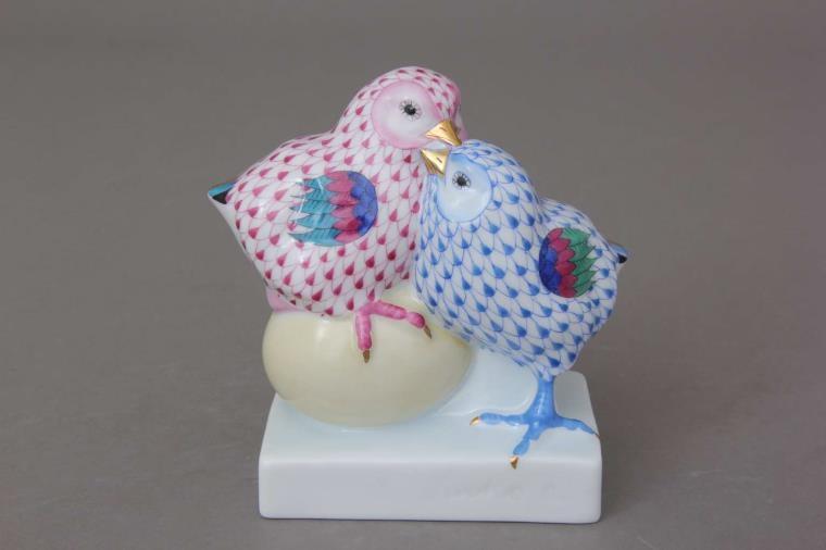Pair of chicks on egg