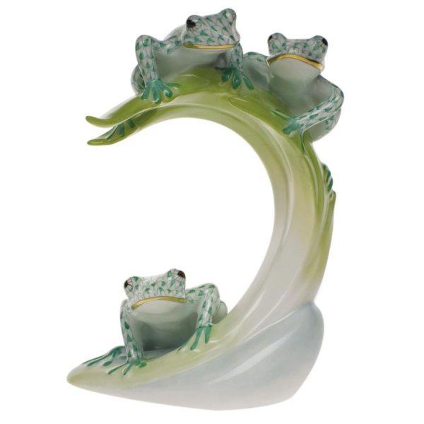 Three tree frogs on leaf