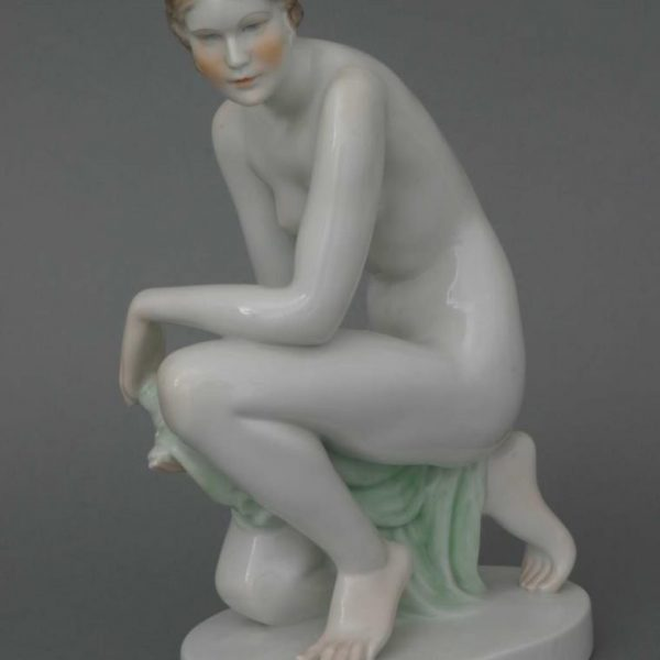 Nude kneeling woman