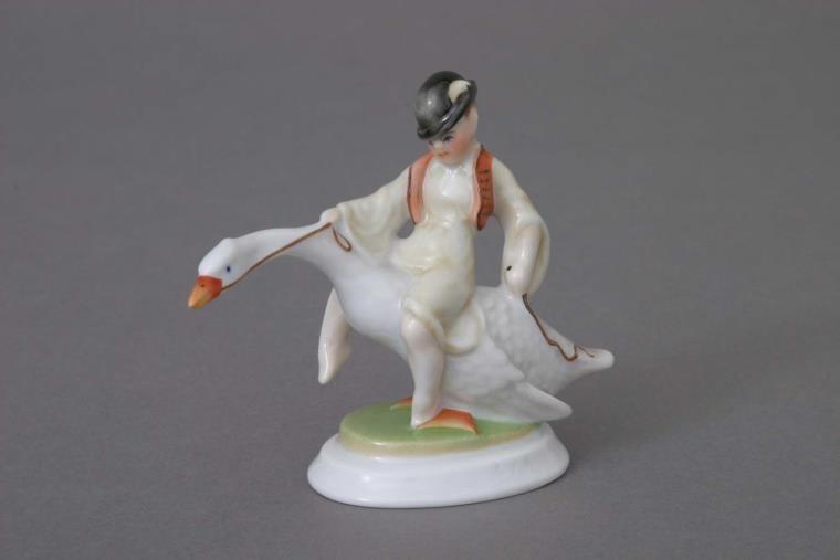 Small boy, riding a goose