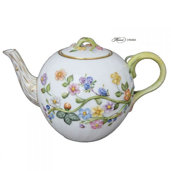 Teapot with flower applications