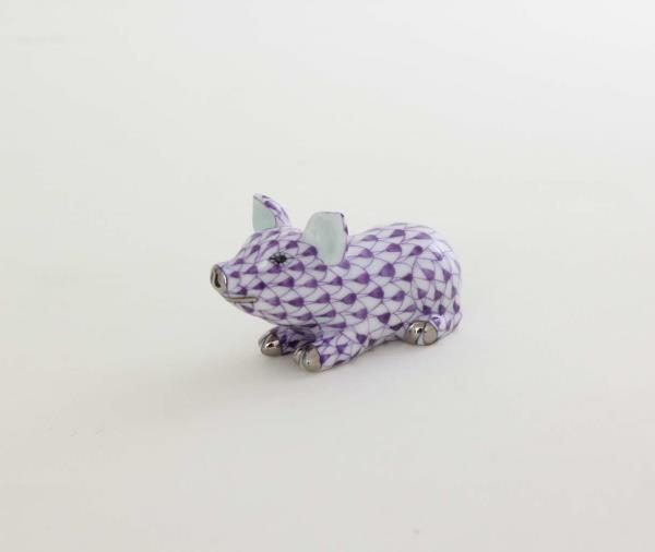 05354-0-00 VHL-PTLittle Pig Lying - Fishnet Purple Small pig figurine with hand painted purple fishnet decor. Available with world wide shipping and gift box packaging