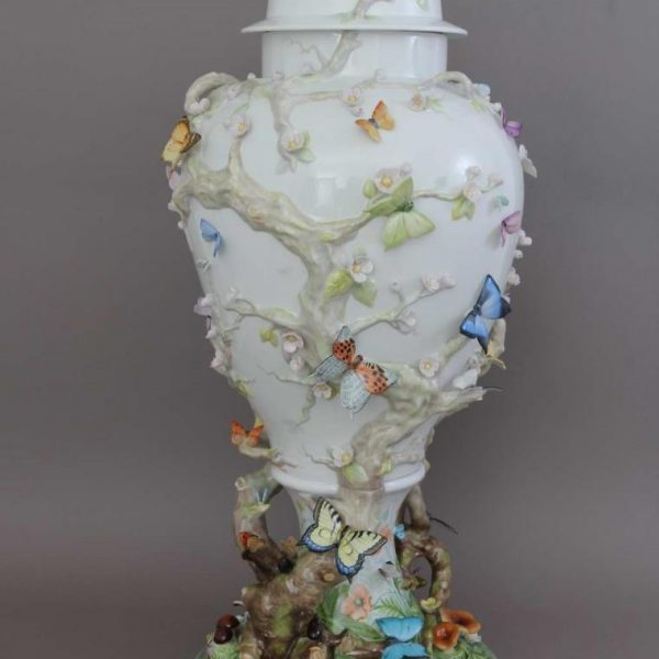 Vase with butterfly ornament