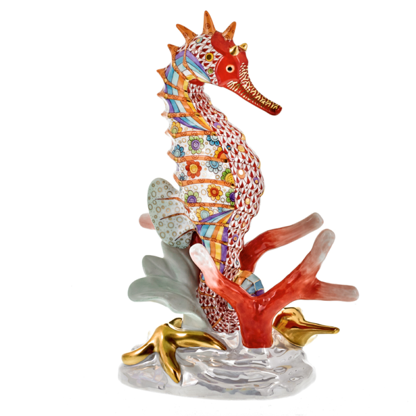 "Seahorse Reserve Herend Reserve Collection Seahorse A gentle seahorse drifts through coral captured here in a rainbow of colors. Porcelain from Hungary, handmade and handpainted with 24k gold accents. New for 2017 in a limited edition of 150.  Measures 3 ¾"" x 5 ¾"" x 8 ¾"" h."