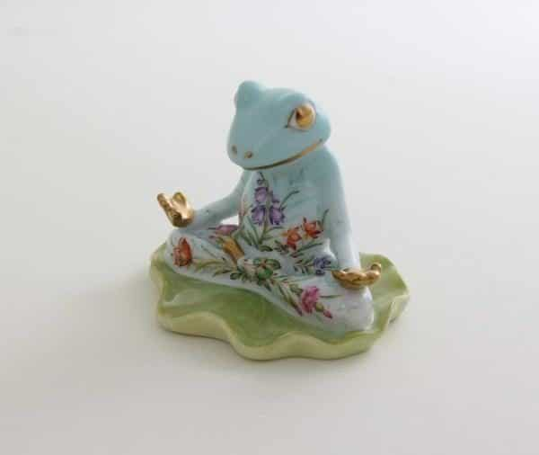 "Herend Yoga Frog Four Seasons QS 05759 Hand painted CO-V1  Masterpiece exclusively at Herend Canada wth world - wide shipping Herend porcelain from Hungary, handmade and handpainted with 24K gold accents. Makes for the perfect gift for that special someone! Measures 2 ½"" l x 2 ¼"" h"