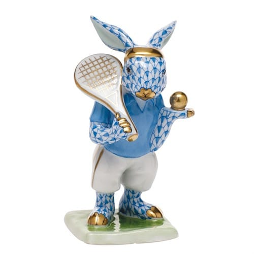 "HEREND TENNIS BUNNY star-1star-2star-3star-4star-5Reviews (2)Write a review New for 2015. This bunny is ready to hit the court in style. Herend porcelain, from Hungary, handmade and handpainted with 24k gold accents. Measures 2 ¼"" x 2"" x 4"" h."