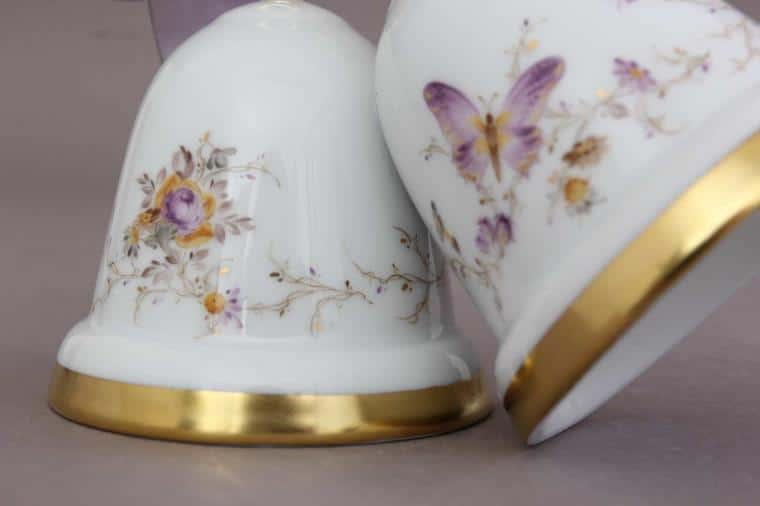 16103-0-00 EDENS Wedding Bells - Eden Butterfly Make your special day unforgettable with this hand-painted wedding bell figurine and ribbons. This Wedding Bell is hand-painted with EDEN butterfly purple decor which is a very elegant and pretty motif.
